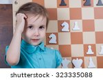 playing chess on the demo board.... | Shutterstock . vector #323335088
