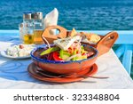 greek salad on table in greek... | Shutterstock . vector #323348804