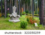 stone sculpture stands in the... | Shutterstock . vector #323350259