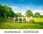 old stone bridge in park   Shutterstock . vector #323353220