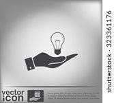 hand holding a lightbulb sign.... | Shutterstock .eps vector #323361176