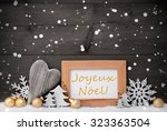 golden decoration on snow....   Shutterstock . vector #323363504