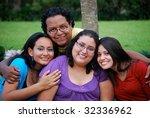 attractive hispanic students | Shutterstock . vector #32336962