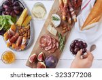 hands getting an olive  cured... | Shutterstock . vector #323377208