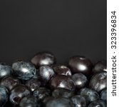 grains of red grapes arranged... | Shutterstock . vector #323396834