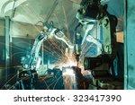 team welding robots represent... | Shutterstock . vector #323417390