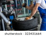 engineer  balancing  car wheel... | Shutterstock . vector #323431664