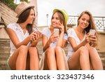 three beautiful young women... | Shutterstock . vector #323437346