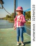 pretty little girl in...   Shutterstock . vector #323464133