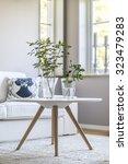 coffee table in clean modern... | Shutterstock . vector #323479283