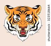 roaring tiger's head.... | Shutterstock .eps vector #323518664