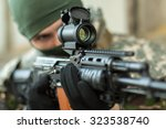 man aiming with an ak 47 with...   Shutterstock . vector #323538740
