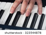 piano playing  close up on... | Shutterstock . vector #323544878
