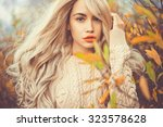 outdoor fashion photo of young... | Shutterstock . vector #323578628
