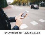 female hands using white blank... | Shutterstock . vector #323582186