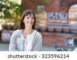 happy woman holding newspaper ... | Shutterstock . vector #323596214