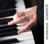 piano playing  close up on... | Shutterstock . vector #323603078
