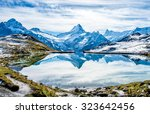 Swiss alps water reflection in  Bachalpsee - mountain lake above Grindelwald, Switzerland.