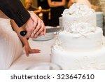 bride and groom at wedding... | Shutterstock . vector #323647610