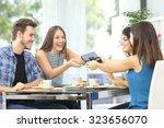 friends celebrating birthday... | Shutterstock . vector #323656070