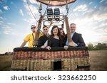 happy group of people posing in ... | Shutterstock . vector #323662250