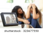 sad wife after a breakup with a ... | Shutterstock . vector #323677550