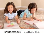 cute little sisters coloring... | Shutterstock . vector #323680418