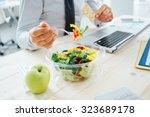 businessman having a lunch... | Shutterstock . vector #323689178