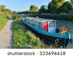 View Of Canal Boats Bathed In...