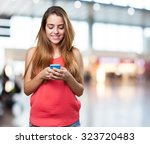 happy young cute woman typing a ... | Shutterstock . vector #323720483