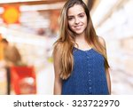 young woman smiling over white... | Shutterstock . vector #323722970