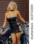 sexy motorcycle biker girl... | Shutterstock . vector #323731004