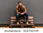 confident and handsome.... | Shutterstock . vector #323733749