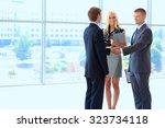 business people shaking hands... | Shutterstock . vector #323734118