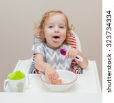 funny baby stick out his tongue ... | Shutterstock . vector #323734334