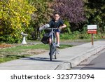 a young boy delivering... | Shutterstock . vector #323773094