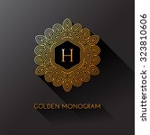 golden elegant monogram with... | Shutterstock .eps vector #323810606
