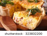 a piece of french quiche... | Shutterstock . vector #323832200