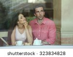 young couple drinking tea and... | Shutterstock . vector #323834828