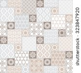 seamless patchwork background.... | Shutterstock .eps vector #323847920