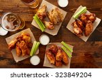 Small photo of many different flavored buffalo chicken wings with beer party sampler sharing platter shot from top down view