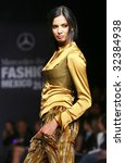 MEXICO CITY - MAY 18: A model walks the runway wearing Alana Savoir Autumn/Winter 2009 during Mercedes-Benz Fashion Mexico Autum/Winter 2009 May 18, 2009 in Mexico City. - stock photo