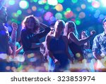 Small photo of party, holidays, celebration, nightlife and people concept - group of happy friends dancing in night club