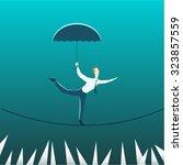 businessman with an umbrella...   Shutterstock .eps vector #323857559