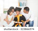 happy indian family graduation  ...   Shutterstock . vector #323866574