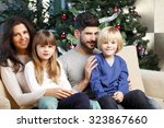 portrait of happy family... | Shutterstock . vector #323867660