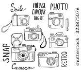 hand drawn set of retro cameras ... | Shutterstock .eps vector #323875076