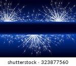 sparkle fireworks on blue... | Shutterstock .eps vector #323877560