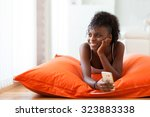 african american woman sending... | Shutterstock . vector #323883338