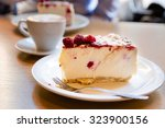 coffee and cheesecake with... | Shutterstock . vector #323900156